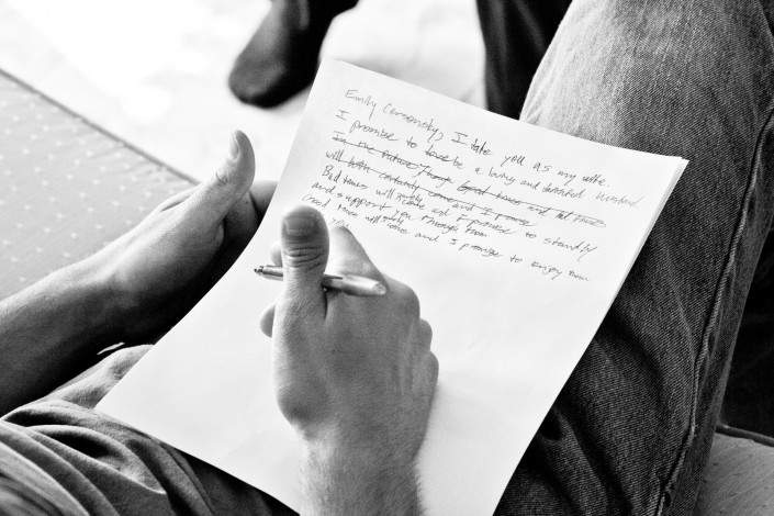 Groom writing his vows on paper at a boston wedding