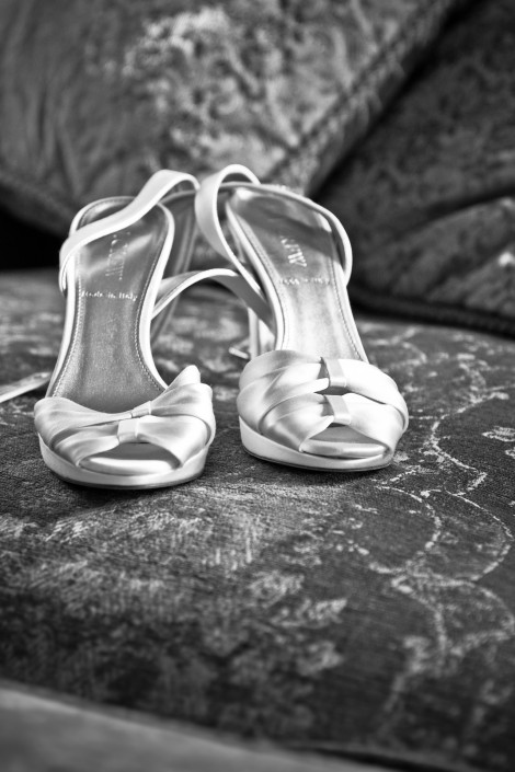 black and white image of bride's shoes at the endicott estate in boston