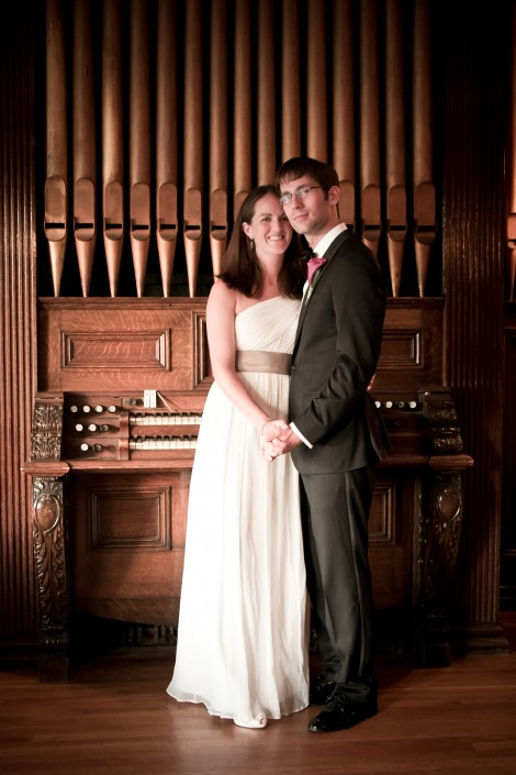 bride and groom photo portrait in front of an old wooden organ at the endicott estate historic wedding venue