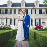 Bride and groom posing in the garden at Hildene