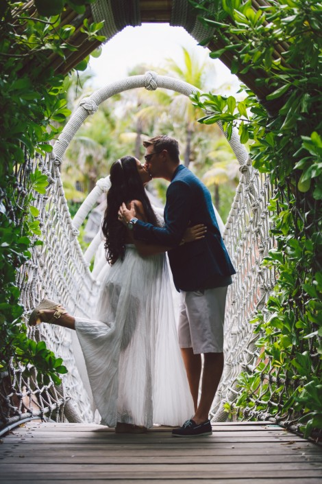 bride and groom wedding portrait on the rope bridge at atlantis paradise island destination wedding