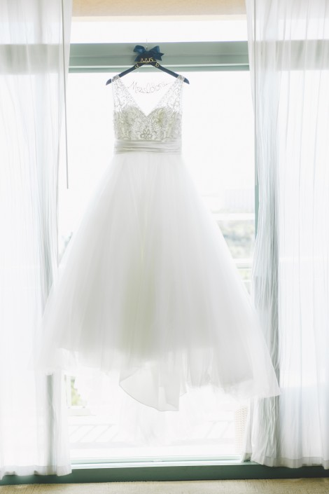 photography of a wedding dress hanging up in the window of a suite at Atlantis resort in paradise island