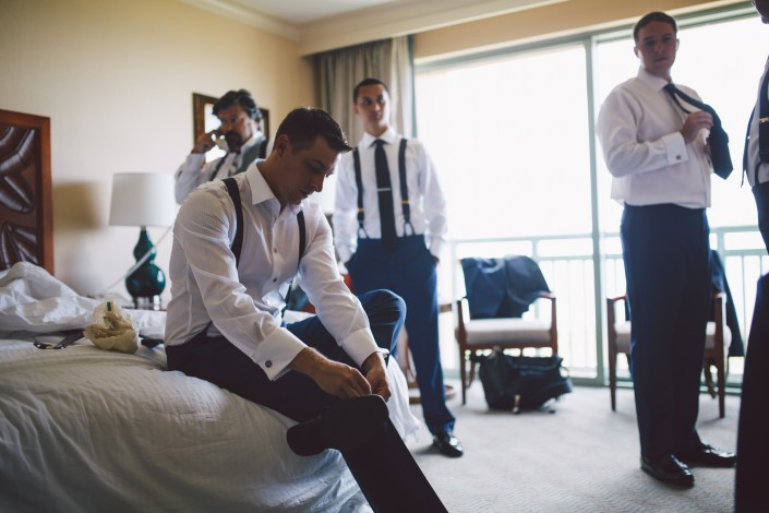 The groom and his groomsmen get dressed and prepared in their suite at the atlantis resort in the bahamas
