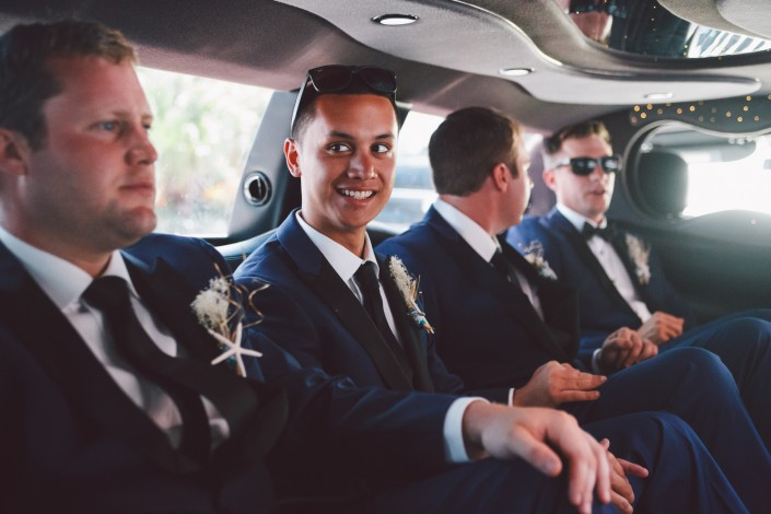 groomsmen in the limo on the way for the wedding ceremony in Nassau
