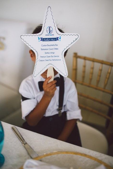 ring bearer at the reception of a wedding of a Bahamas destination wedding by Erik Kruthoff Photography