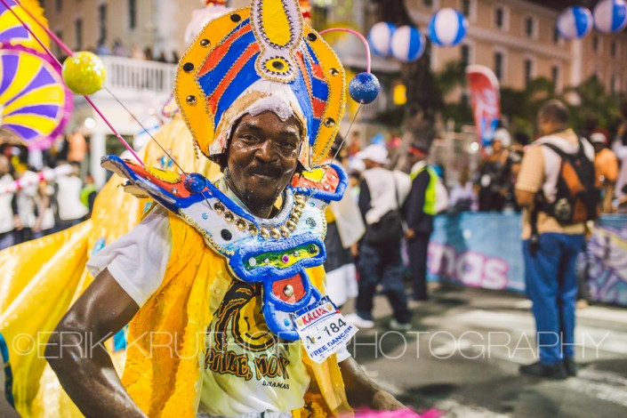 Man dancing and blowing a whistle in a junkanoo rush out