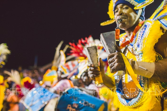 a man plays the cowbells in the annual junkanoo parade in the bahamas