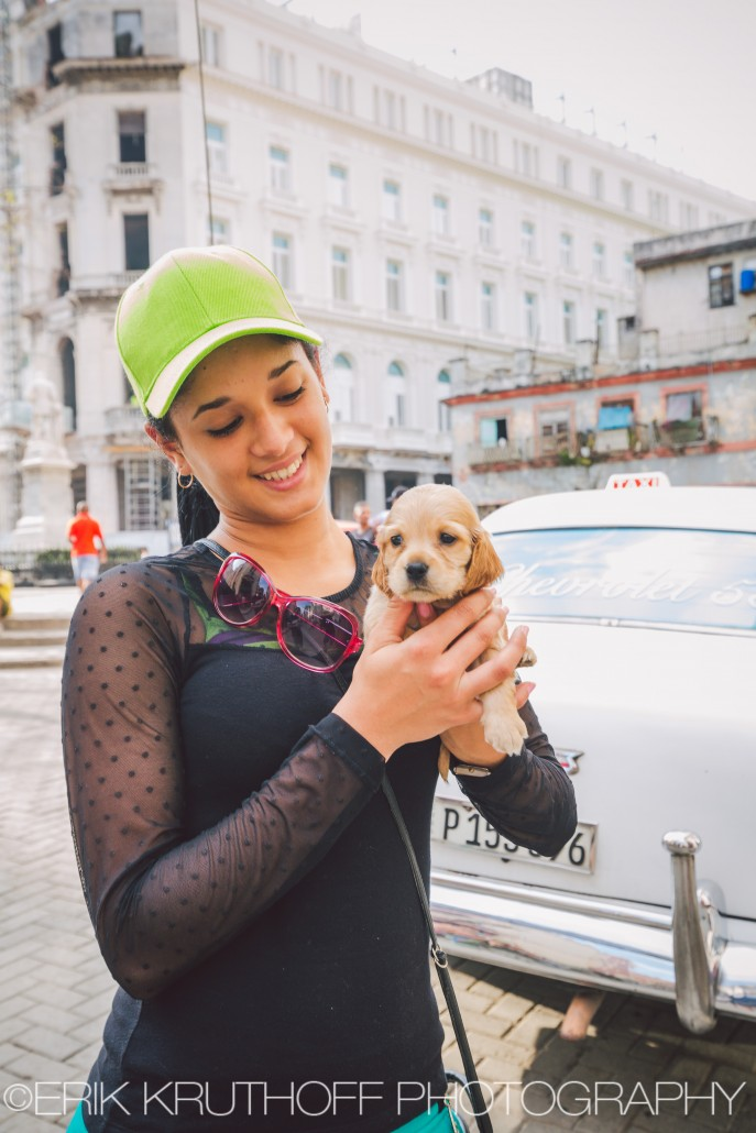 Cuban girl holding a puppy