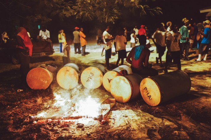 junkanoo bass drums next to a bonfire