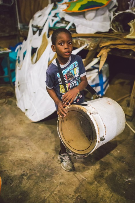 child drummer in junkanoo shack