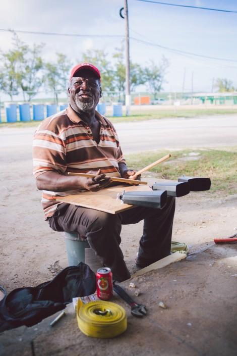 musician prepares for Junkanoo in Eleuthera, bahamas