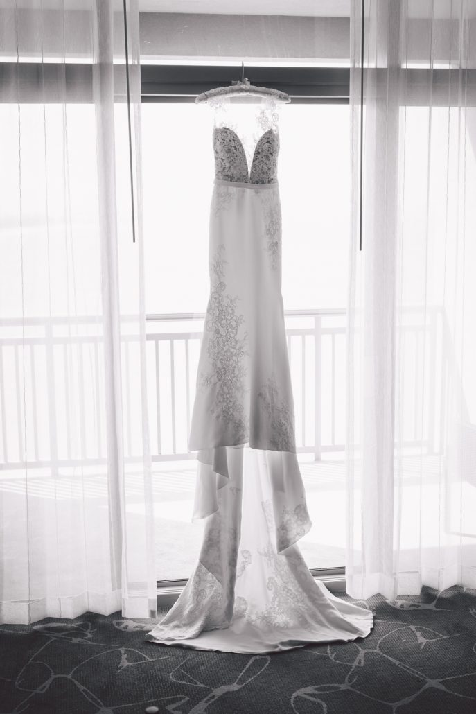 black and white wedding photo of bride's dress