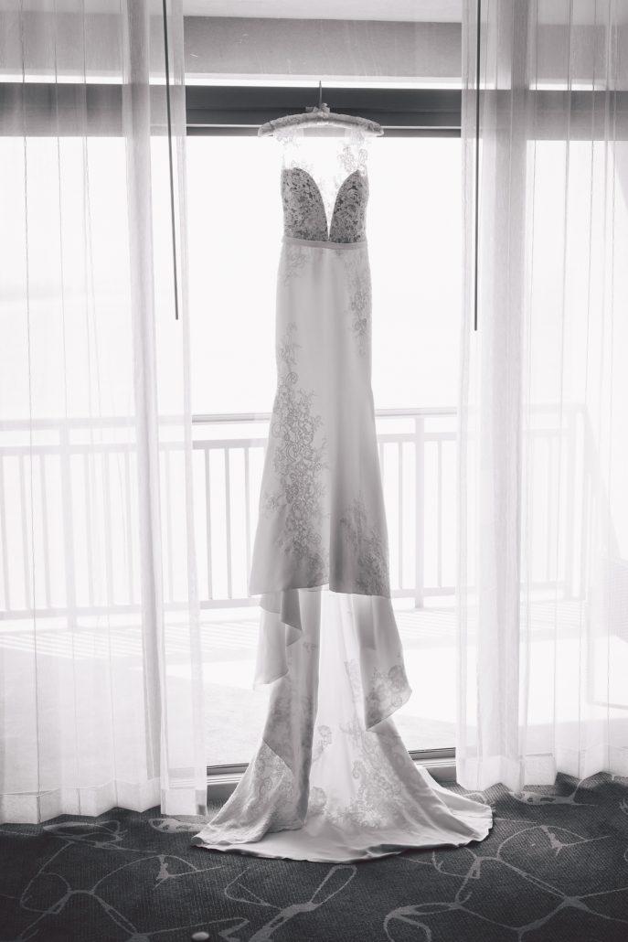 black and white wedding photo of bride's dress