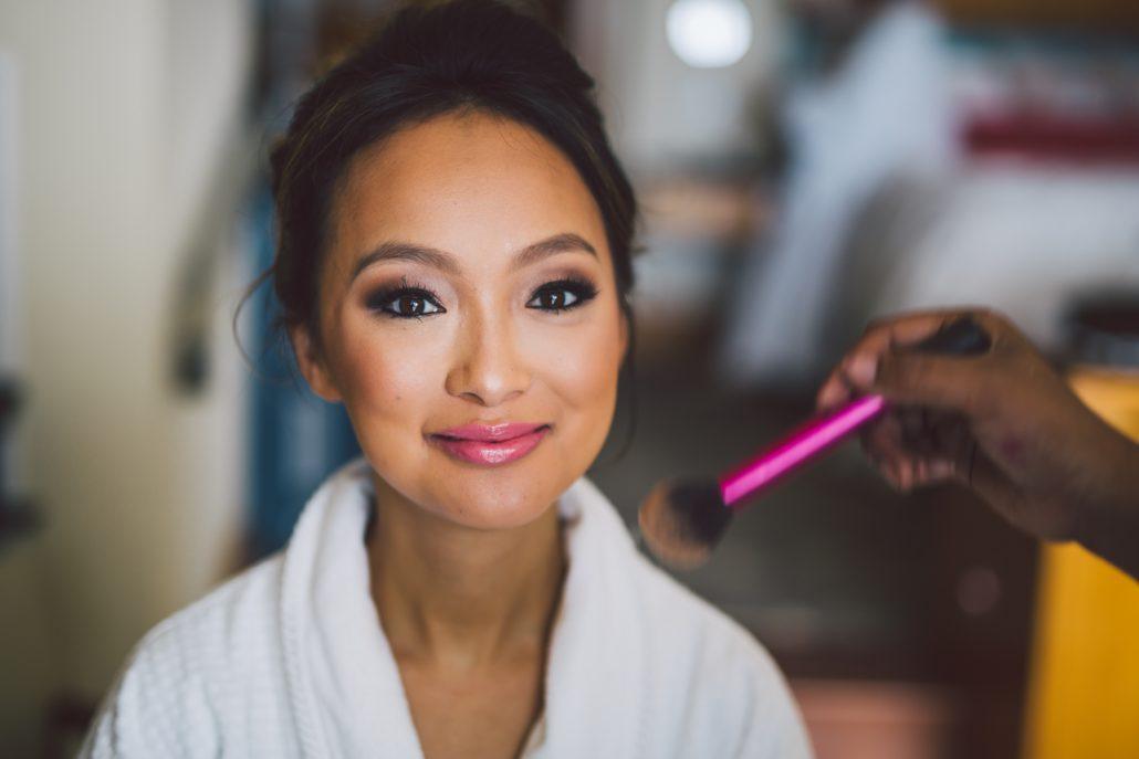 bride getting makeup at the cove atlantis suite
