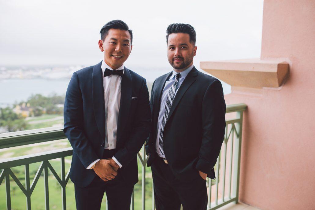 wedding photography. groom and best man on hotel balcony
