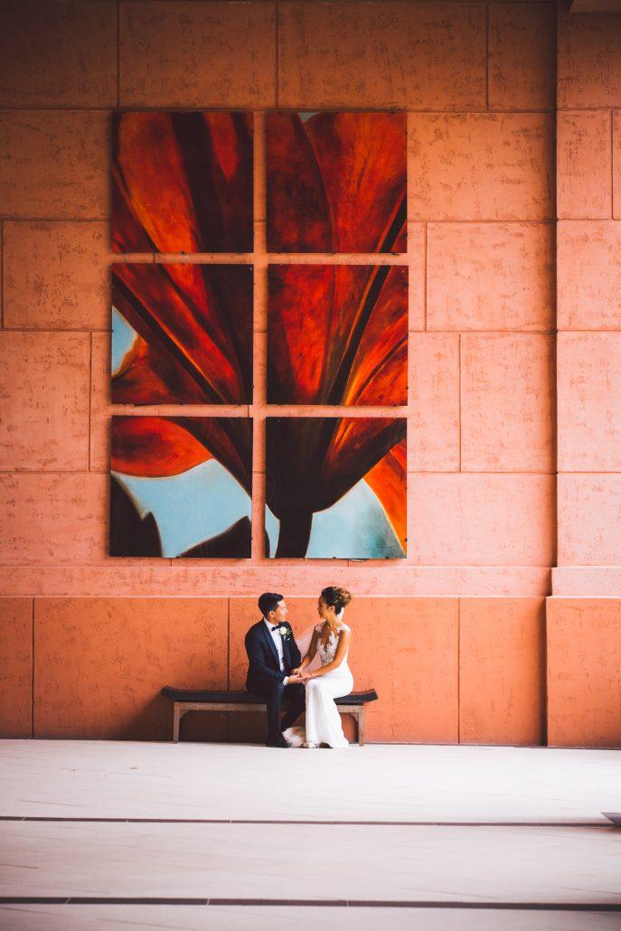 bride and groom posing outside the reef atlantis