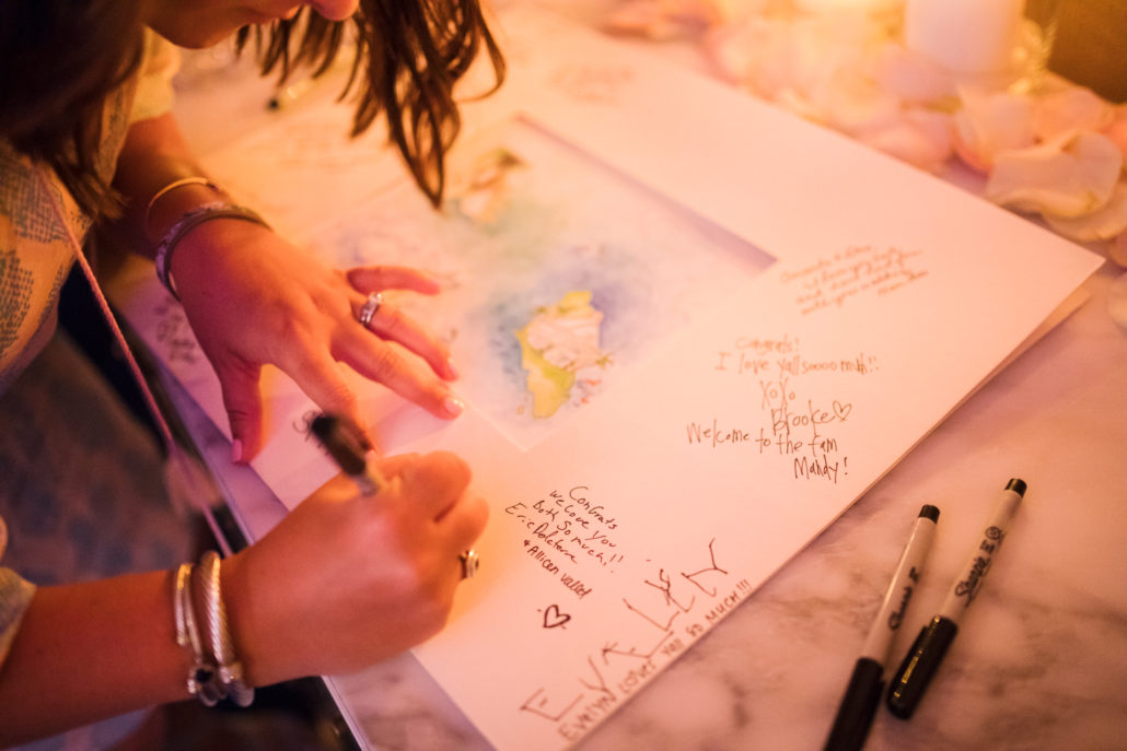 signing guestbook at baha mar wedding reception