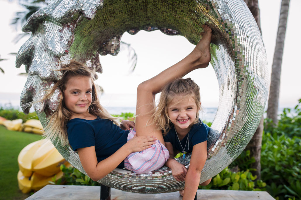 sisters posing together for a family photo at Ritz-Carlton Dorado Beach, Puerto Rico