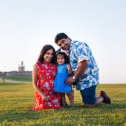 family posing for a photo at el morro in old san juan puerto rico